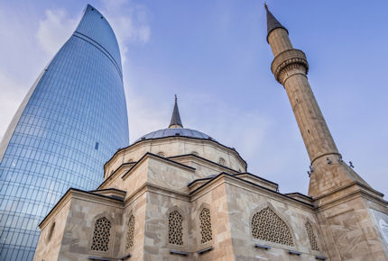 The Turkish Mosque stands in the Flame Towers' shadow
