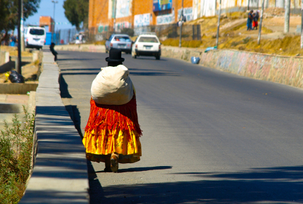 A cholita walking along the streets of El Alto