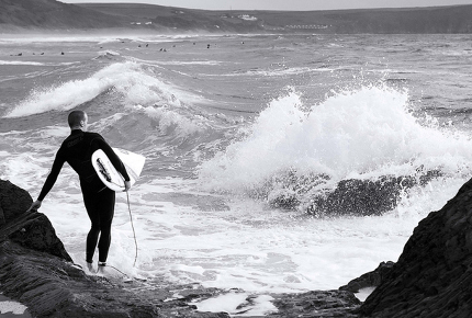 A surfer weighs up the swell in Woolacombe