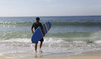 Brendan, who runs Riyue Bay Surf Club, heads for the water