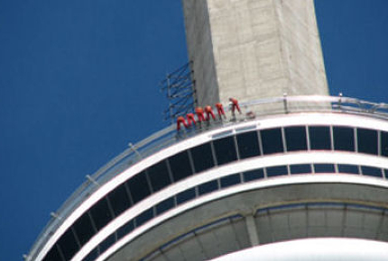 Daredevils dangle from the edge of Toronto's CN Tower