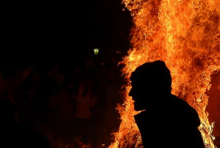 Fire-jumping at Novruz Festival is said to burn away any lingering woes