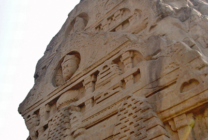 Masroor's carving of a deity looks remarkably like the Buddha