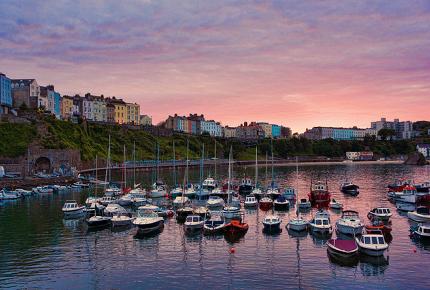 Pastel-hued buildings overlook Tenby's shimmering harbour