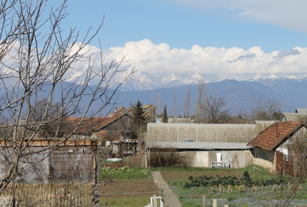 The village is overlooked by the Caucasus Mountains