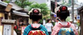 Geishas walking down a Kyoto street