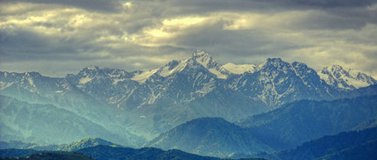 Almaty is framed by the snow-capped peaks of the Zailysky-Alatau mountains,