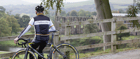 A cyclist looks over the Bolton Abbey ruins