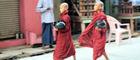 Novice monks walk through the streets of Yangon