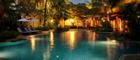 Romantically lit pool at Settha Palace Hotel