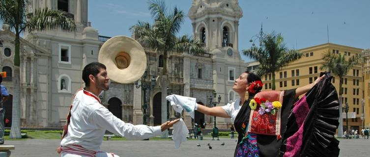 Marinera dancers in front of Lima's cathedral