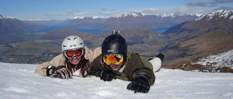 Snowboarders atop Coronet Peak