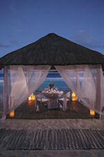 Dine at night in a private cabana