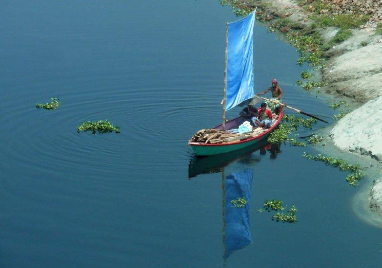 A seasonably low fishing pond outside of Khulna, Bangladesh