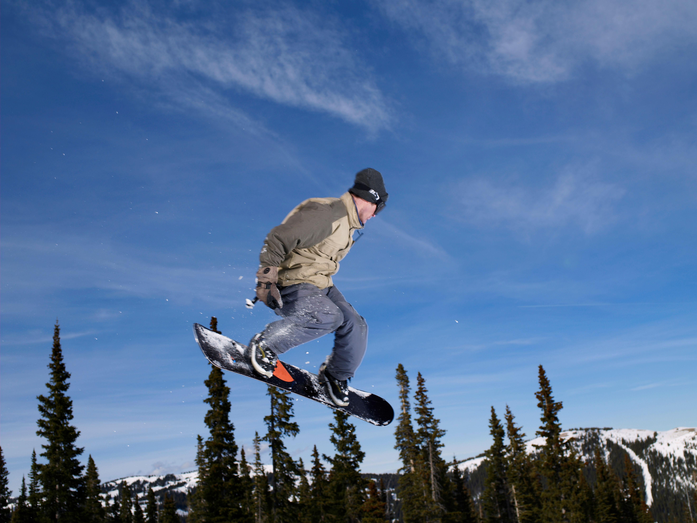 Snowboarder in midair, Colorado