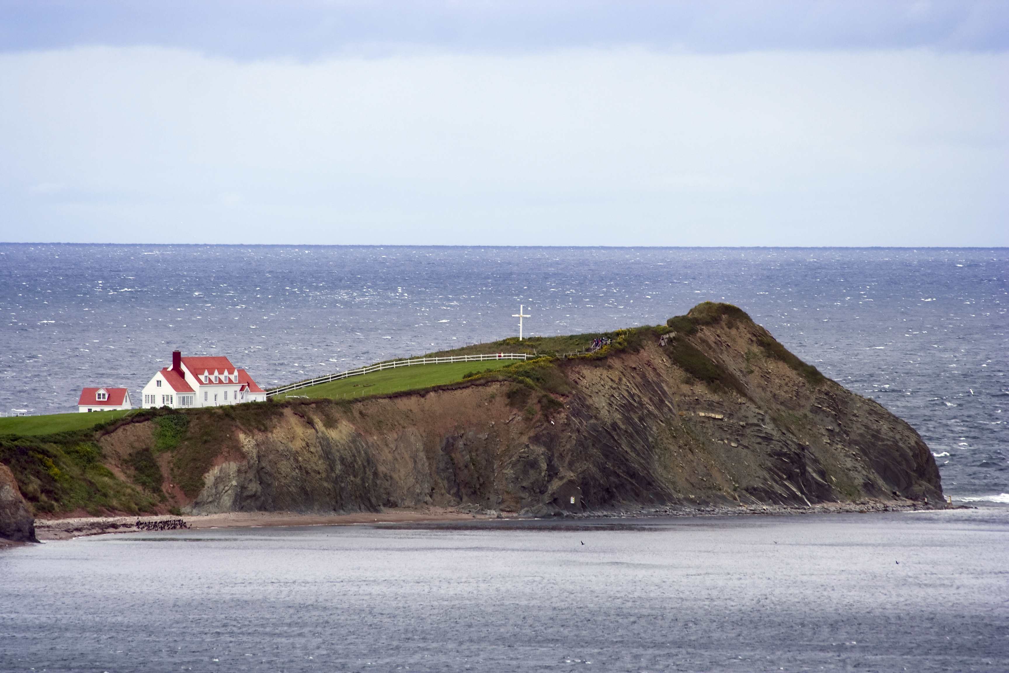Peninsula with red house on the coast in Quebec