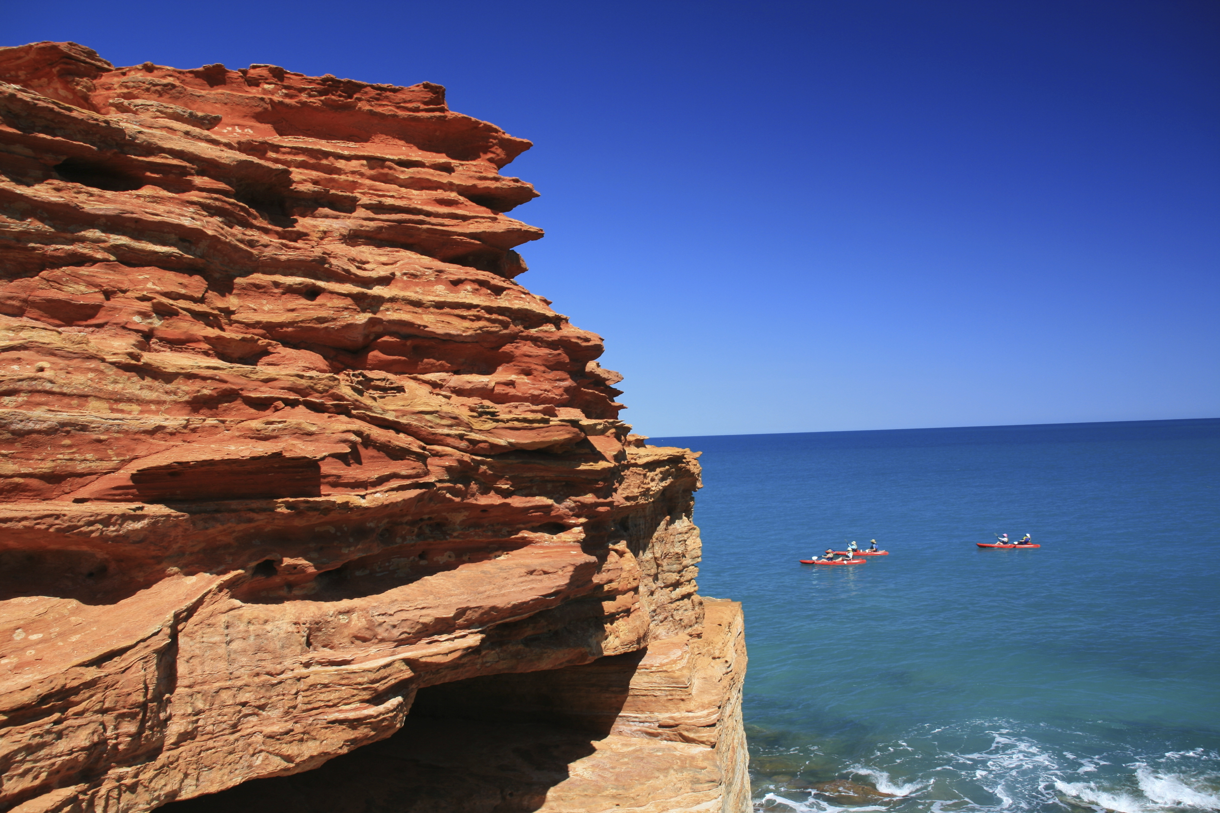 Coanoeing off the red cliffs of West Australia